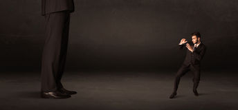 Huge man with small businessman standing at front concept Stock Photo