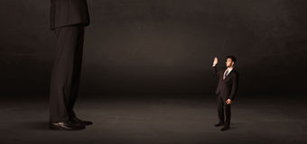 Huge man with small businessman standing at front concept Royalty Free Stock Image