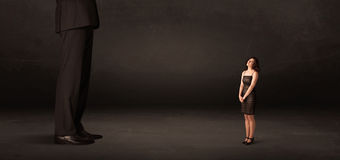 Huge man with small businesswoman standing at front concept Royalty Free Stock Image