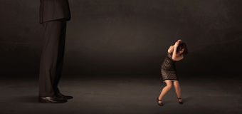 Huge man with small businesswoman standing at front concept Royalty Free Stock Images