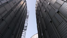 Huge metal buildings, up view.