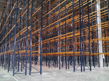 Huge modern empty storehouse. With metallic constructions Stock Images