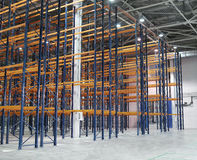 Huge modern empty storehouse. With metallic constructions Stock Photography