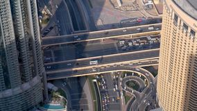 Huge modern intersection in Dubai , view from top. In daytime stock footage