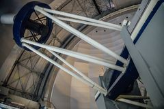 Huge modern professional astrophysical telescope under dome of observatory.  royalty free stock photo