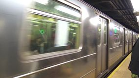 Huge modern silver steel urban subway car train moving fast arriving at busy city downtown tube metro station 4k shot stock video footage