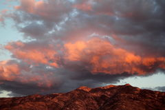 Huge monsoon clouds over the Santa Catalina mountains at sunset in Tucson Arizona Stock Photography