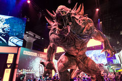 Huge monster at evolve booth at E3 2014 Royalty Free Stock Photos