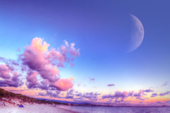 Huge moon over Alghero at sunset Royalty Free Stock Photos