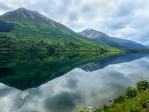 Huge Mountains Reflect in Water in Alaska stock image