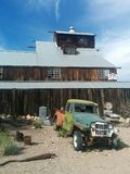 Huge multi-story wooden barn in desert with vintage truck Royalty Free Stock Photos