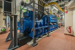 Huge natural gas engine works in a combined heat and power plant and supplies a district with heat royalty free stock photos