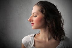 Huge nose. Profile of a woman with huge nose Stock Photo