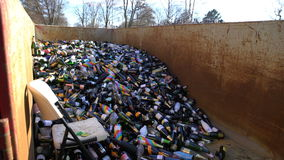 Huge number of empty wine bottles in the dumpster. HELSINKI, FINLAND - MAY 1, 2017: Huge number of empty wine bottles in the dumpster during the celebration of stock video