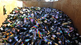 Huge number of empty wine bottles in the dumpster. HELSINKI, FINLAND - MAY 1, 2017: Huge number of empty wine bottles in the dumpster during the celebration of stock footage