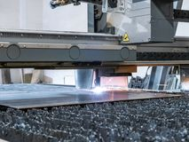 Numeric CNC plasma cutter, cuts metal parts from sheet of steel royalty free stock photography