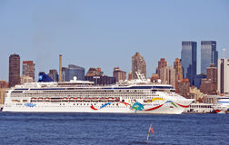 Huge Ocean Linear Norwegian Dawn. NEW YORK - September 13: Huge Ocean Linear Norwegian Dawn brings tourists out of NYC on the Hudson river with NYC in the Royalty Free Stock Photography