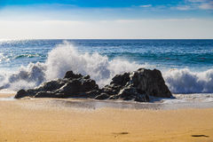 Huge ocean waves crushing on rocks in Garrapata State Beach in C Royalty Free Stock Photo