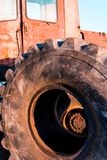 Huge old dirty car wheels kind of inside. Tractor Stock Photos
