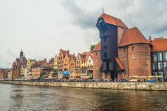 Mediaeval mast crane in Gdansk. Huge old medieval building of mast crane for setting masts on sailships in Gdansk, northern Poland. Part of Polish National Stock Images