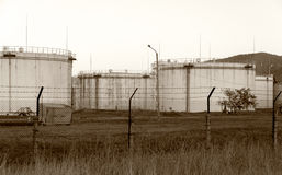 Huge old rusty fuel tanks. Fuel tanks in poor condition, unsupported Stock Images