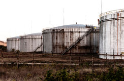 Huge old rusty fuel tanks. Fuel tanks in poor condition, unsupported Royalty Free Stock Image