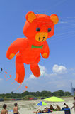 Huge orange bear kite on the beach Stock Photos