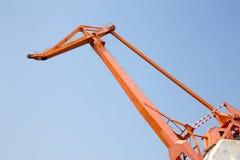 Huge orange crane in front of blue sky Royalty Free Stock Photos