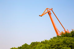 Huge orange crane in front of blue sky Royalty Free Stock Photography