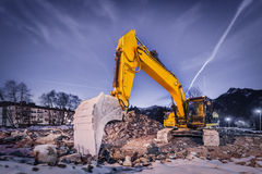 Huge orange shovel digger on demolition site Royalty Free Stock Photography