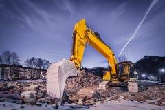 Huge orange shovel digger on demolition site Royalty Free Stock Photography