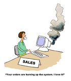 Huge Order. Business cartoon showing businesswoman at a computer that has smoke coming out of it, 'Your orders are burning up the system.  I love it Stock Image