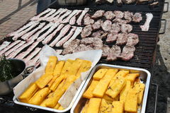 Huge outdoor barbecue grill with pork sausage and beacon Royalty Free Stock Images