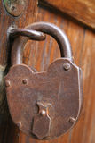 Huge padlock. Huge old padlock on a frontdoor of a church Royalty Free Stock Photography