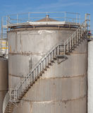 The huge petrol oil tanks with stairs exterior in refinery indus Stock Photos