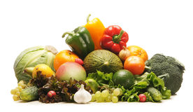 A huge pile of fresh fruits and vegetables. A huge pile of fresh and tasty fruits and vegetables. The image is isolated on a white background Royalty Free Stock Photography
