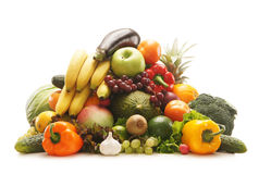 A huge pile of fresh fruits and vegetables. A huge pile of fresh and tasty fruits and vegetables. The image is isolated on a white background Royalty Free Stock Photo