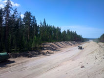 Huge pile of sand for road construction Royalty Free Stock Images