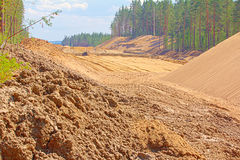 Huge pile of sand for road construction Stock Photos
