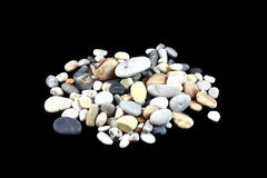 Huge pile of sea stones. On a black background are sea stones Royalty Free Stock Photography