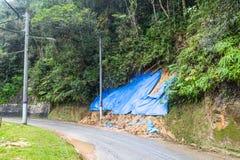 Huge plastic sheets used to temporarily halt slope soil erosion Royalty Free Stock Image