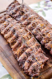 Huge pork ribs. Marinated in wine and barbecued stock photos