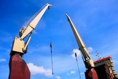 Huge port cranes working. Royalty Free Stock Photos