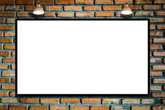 Huge poster advertising billboard on brick wall with lamp. Royalty Free Stock Photo