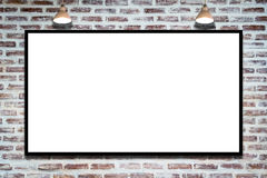 Huge poster advertising billboard on brick wall with lamp. Huge poster advertising billboard on brick wall with lamp, Advertising poster sign, Template mock up Stock Photos