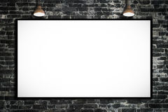 Huge poster advertising billboard on brick wall with lamp. Royalty Free Stock Photography