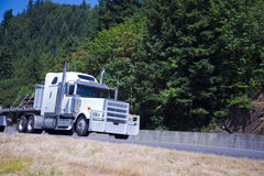 Huge powerful truck with protective grille with load on highway Royalty Free Stock Photos