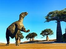 Huge prehistoric dinosaur. Iguanodon standing on hind legs in jurassic desert stock photography