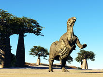 Huge prehistoric dinosaur. Iguanodon standing on hind legs in jurassic desert stock image