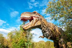 A huge prehistoric scary dinosaur. Stands in the attacking pose royalty free stock photos